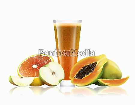 glass of orange apple and papaya