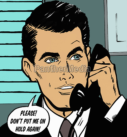 handsome businessman talking on telephone in