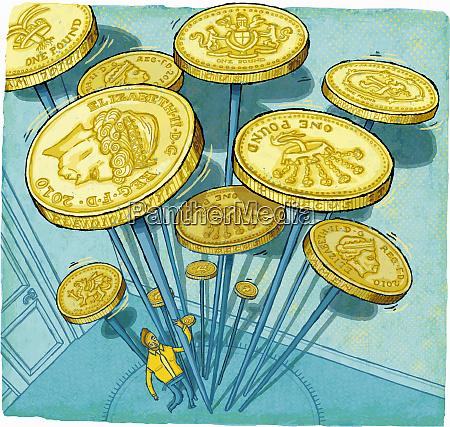 businessman struggling to spin british pound