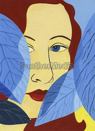 woman peering from behind leaves