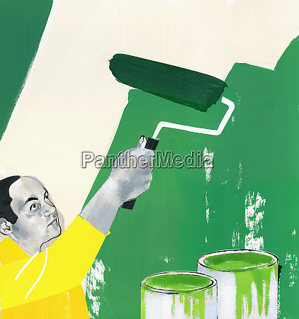 man painting wall green