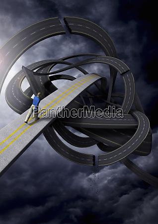businessman walking on tangled winding road