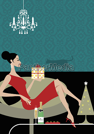 woman drinking champagne and holding christmas