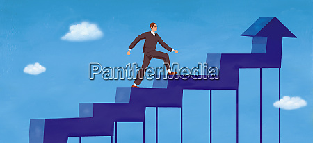 businessman climbing arrow shaped staircase