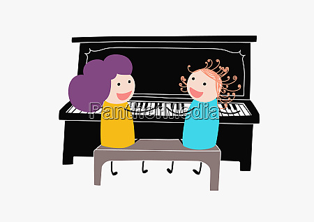children playing duet on piano