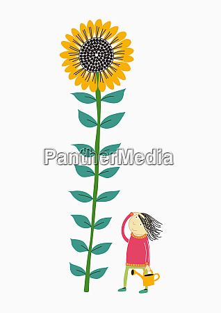 girl watering sunflower