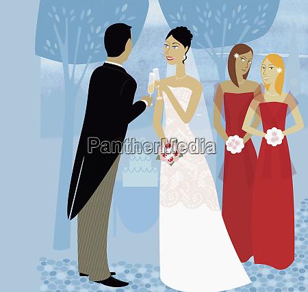 bridesmaids watching bride and groom toasting