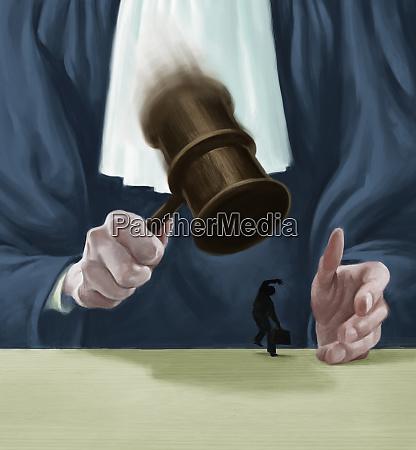 large judge banging gavel on small