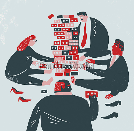 businesspeople playing with building blocks
