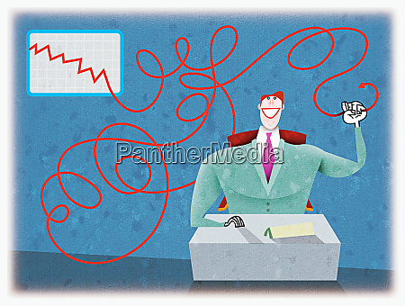 businessman holding line graph