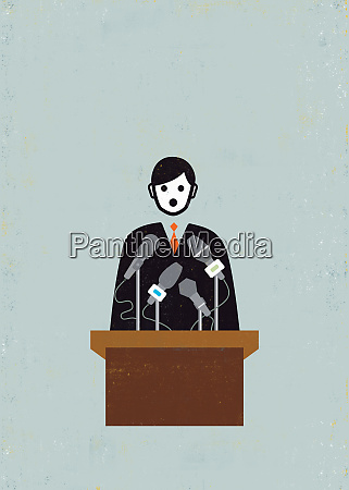 politician making speech at podium with
