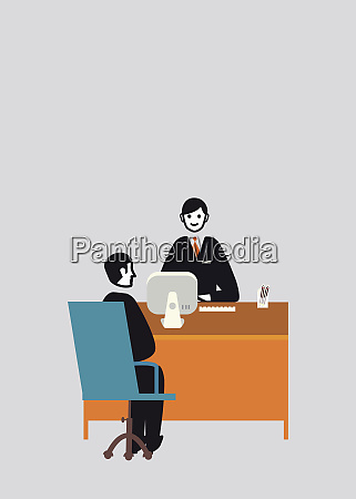 businessman behind office desk interviewing man