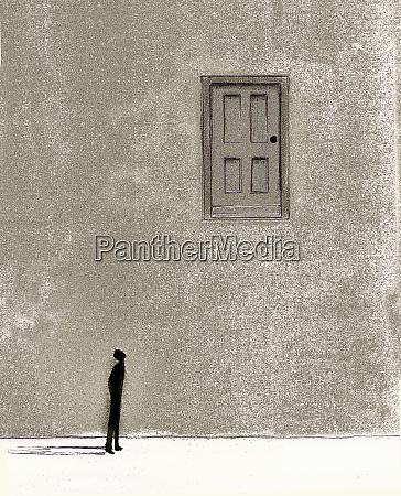 man looking up at door high