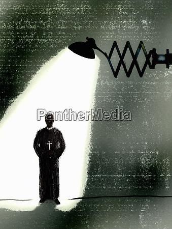 spotlight shining on priest