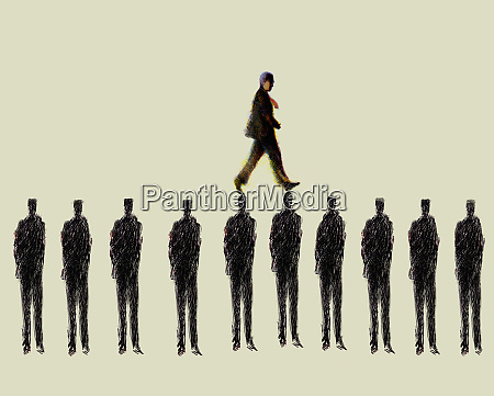 businessman walking over row of businessmen