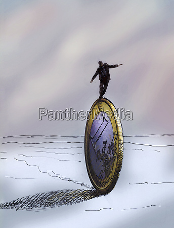businessman balancing on large euro coin