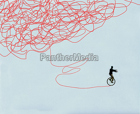 man successfully improving balance on unicycle