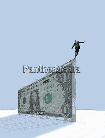 businessman balancing at the edge of