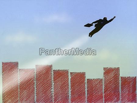 superhero businessman flying above bar graph