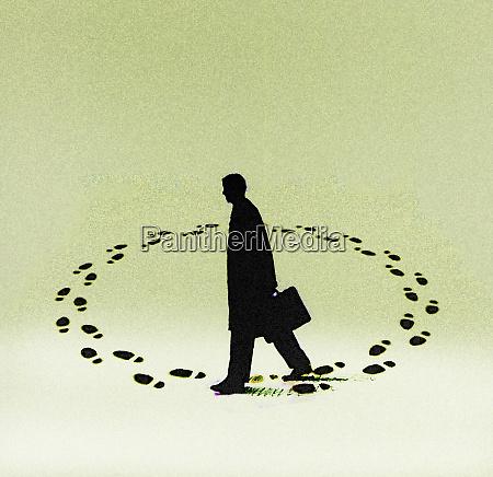 businessman walking in endless circle