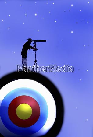 man with telescope standing on target