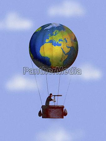 man looking through telescope in globe