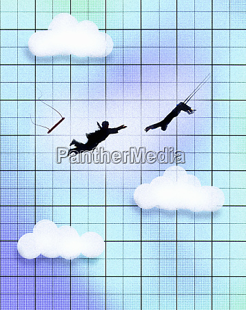businessman swinging on trapeze catching colleague