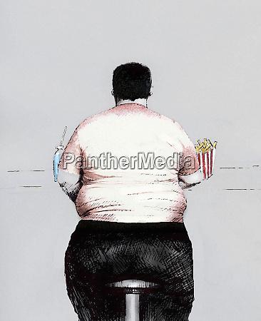 obese man eating unhealthy food at