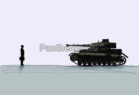 military tank pointed at businessman
