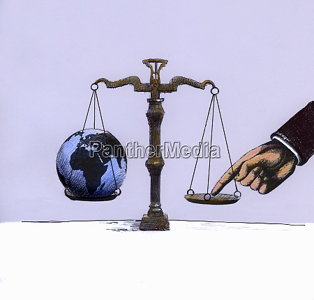 businessman tipping scale opposite globe