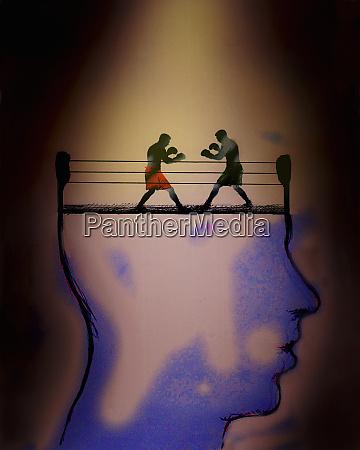 two men boxing inside of mans