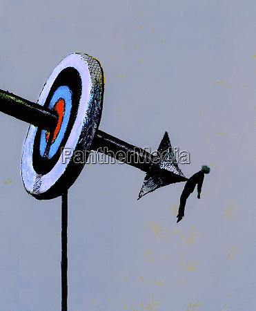 arrow piercing bulls eye and businessman