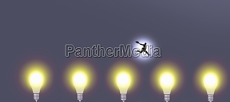 businessman jumping over glowing light bulbs