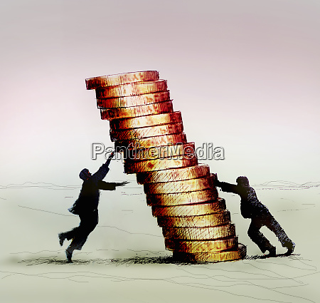 strong businessman pushing pile of coins
