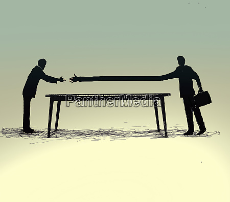 businessman extending arm in effort to