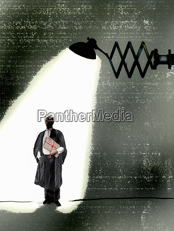 barrister holding legal documents under spotlight