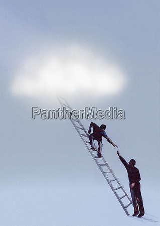 man reaching up to helping hand