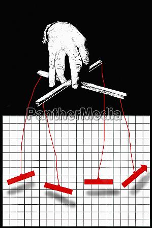 businessman puppeteer manipulating graph