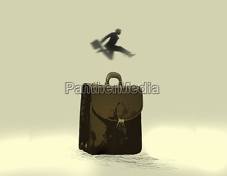 businessman jumping over briefcase
