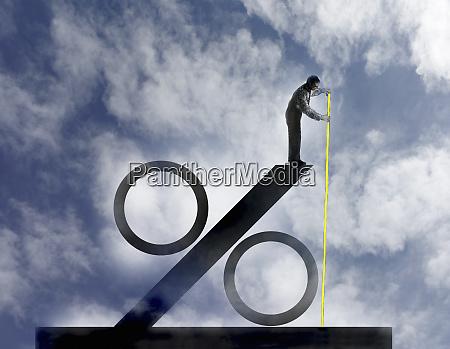 businessman measuring size of large percentage
