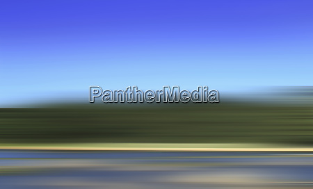 abstract blurred motion road and grass