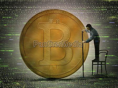 man measuring size of bitcoin