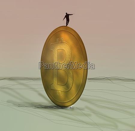 businessman balancing on bitcoin