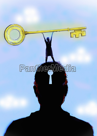 woman holding large key on top