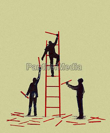 businessmen working together to build ladder