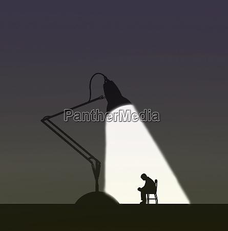 depressed man under the spotlight