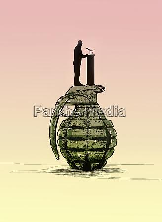 politician making speech standing on top