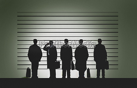 businessman, on, phone, in, police, line-up - 26008209