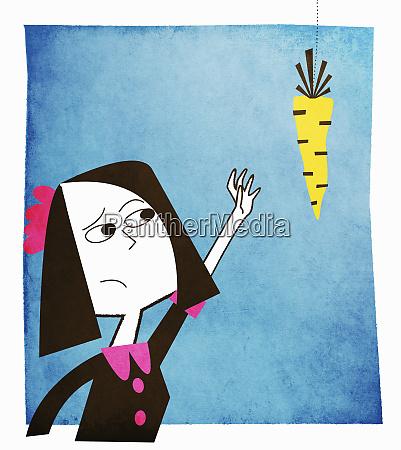 woman reaching for dangling carrot
