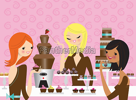 young women enjoying eating chocolate together